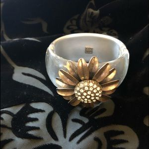 Grey pearlized cuff with rotating flower